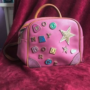 Dooney and Bourke pink convertible backpack